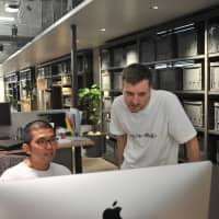Ryohei Miyota (left), who oversees engineer recruiting at Line Corp.'s Kyoto office, and German engineer Frederik Vogel are seen working at the company's office in the ancient Japanese capital in September.   KAZUAKI NAGATA