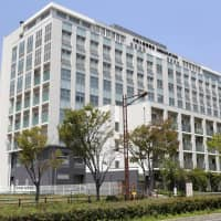 Seventeen foreign detainees were locked in a room for six people in this building of the Osaka Regional Immigration Bureau in Osaka Prefecture in June. | KYODO