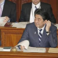 Abe says government will set 'cap' on number of foreign workers under new visa types