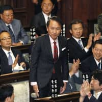 Japan's ruling bloc votes down motion to remove head of judiciary committee amid clash over immigration bill