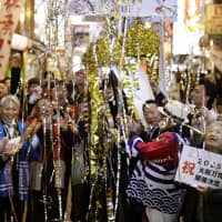 Streamers fall after Osakans hear the news that their city won the honor of hosting the 2025 World Expo. | KYODO