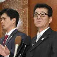 Osaka Gov. Ichiro Matsui and Osaka Mayor Hirofumi Yoshimura answer reporters' questions in Paris on Thursday. | KYODO