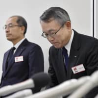 KYB Corp. Executive Vice President Takaaki Kato (right) apologizes at the start of a news conference in Tokyo on Nov. 6. | KYODO