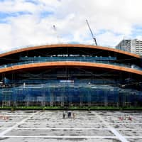 Tokyo 2020: Workers raise section of giant roof at tradition-inspired Olympic gymnastics venue