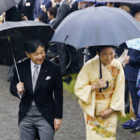 Crown Prince Naruhito and Crown Princess Masako attend an Imperial garden party at the Akasaka Imperial Gardens in Tokyo on Friday. | KYODO