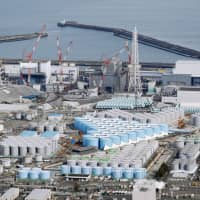 The growing number of tanks storing radioactive water at the Fukushima No. 1 plant can be seen in February. | KYODO