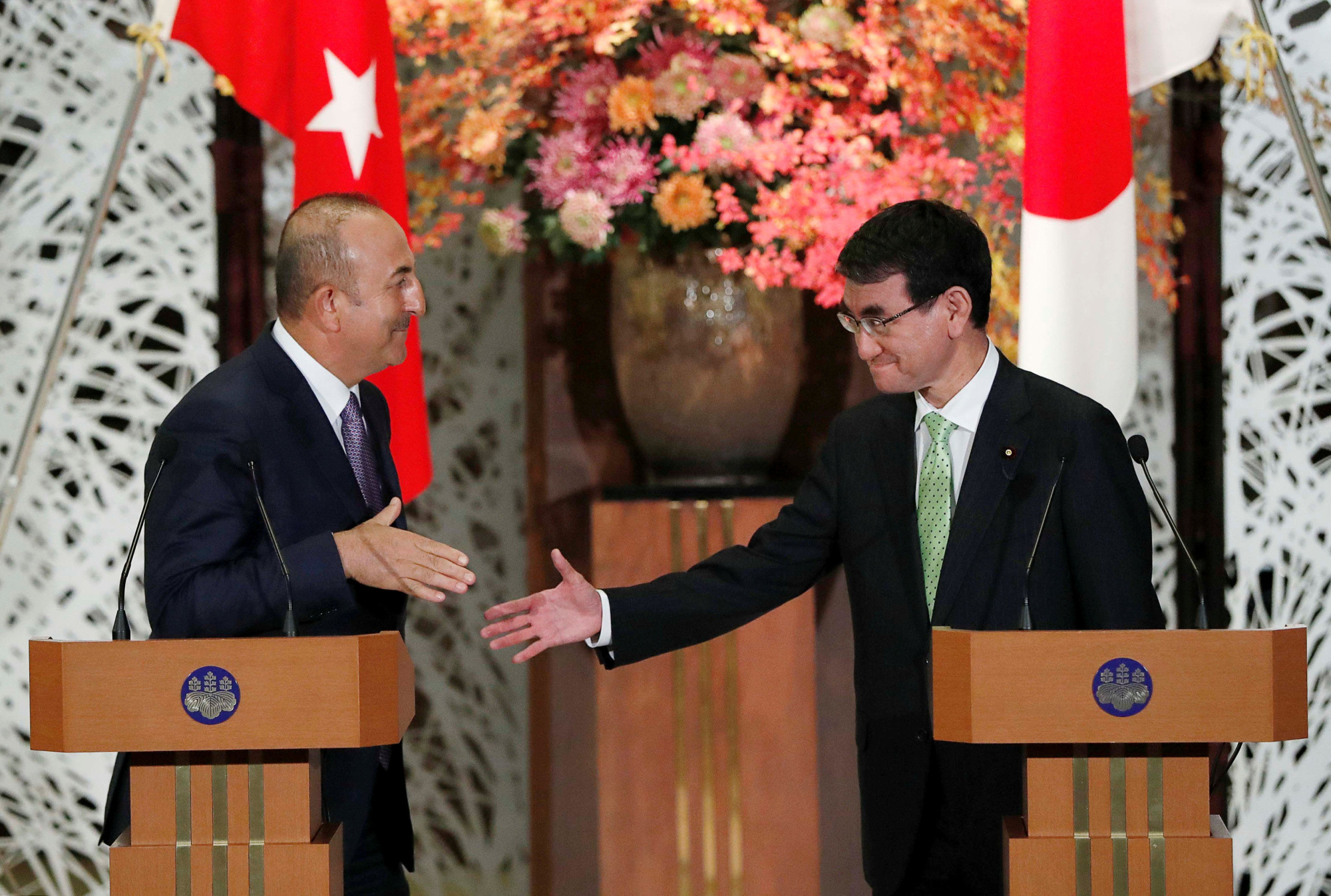 Foreign Minister Taro Kono and his Turkish counterpart, Mevlut Cavusoglu, hold a news conference in Tokyo on Monday. | REUTERS