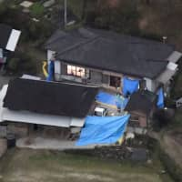 An aerial photo taken Monday shows a house in Miyazaki Prefecture where six bodies, including that of a young girl, were discovered. | KYODO