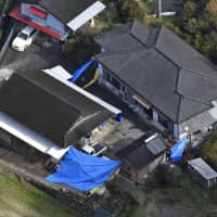 A house in Takachiho, Miyazaki Prefecture, where six people were found murdered Monday, is seen in this aerial photo taken Tuesday afternoon. | KYODO