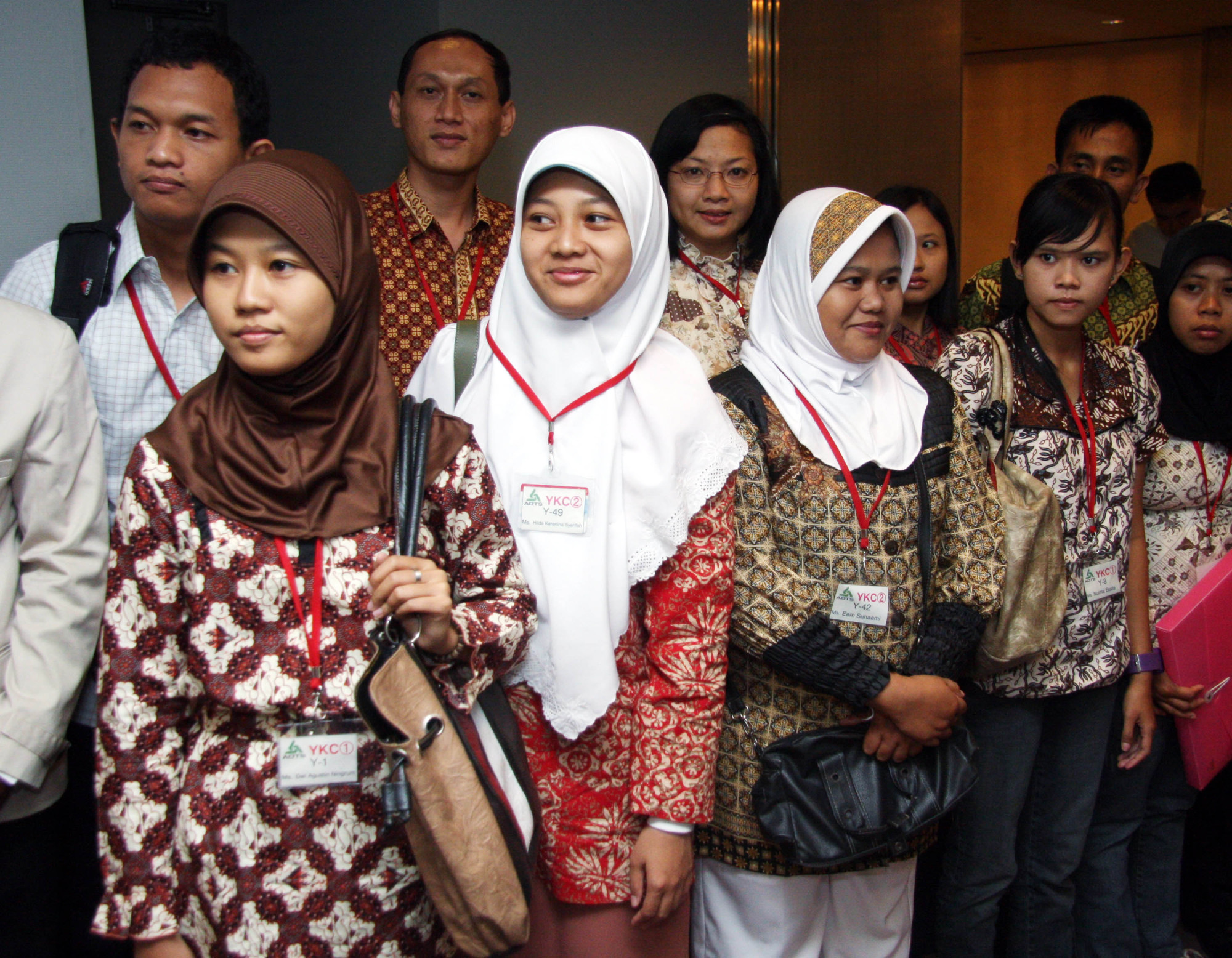 Indonesian nursing interns arrive at an opening ceremony for a Japanese school in Tokyo in August 2008. A survey published Tuesday has revealed that 59 percent of the public think immigrants make the country stronger because of their work and talents. | BLOOMBERG