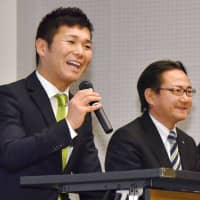 Rizap CEO Takeshi Seto (left) announces the firm's acquisition of the managing rights for soccer club Shonan Bellmare in April in Tokyo. | KYODO
