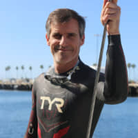 Ben Lecomte ends bid to swim from Japan across Pacific after support boat suffers damage