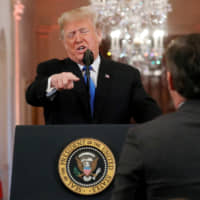 U.S. President Donald Trump points at CNN's Jim Acosta and accuses him of 'fake news' during a news conference at the White House on Wednesday. | REUTERS