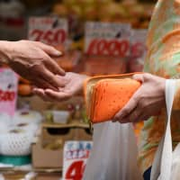 Effort to nudge Japan to go cashless with offsets to sales tax hike faces many hurdles
