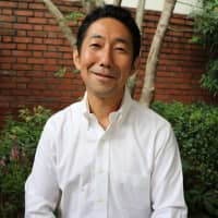 Of sound mind: Junya Ogino teaches mindful leadership courses that he says can act as a panacea for the stress and chaos of Japanese corporate life. | KYODO
