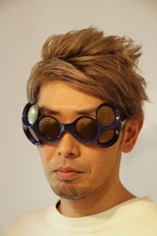 Eye-catching accouterment: Toshihiro Hasegawa dons a pair of Factory900