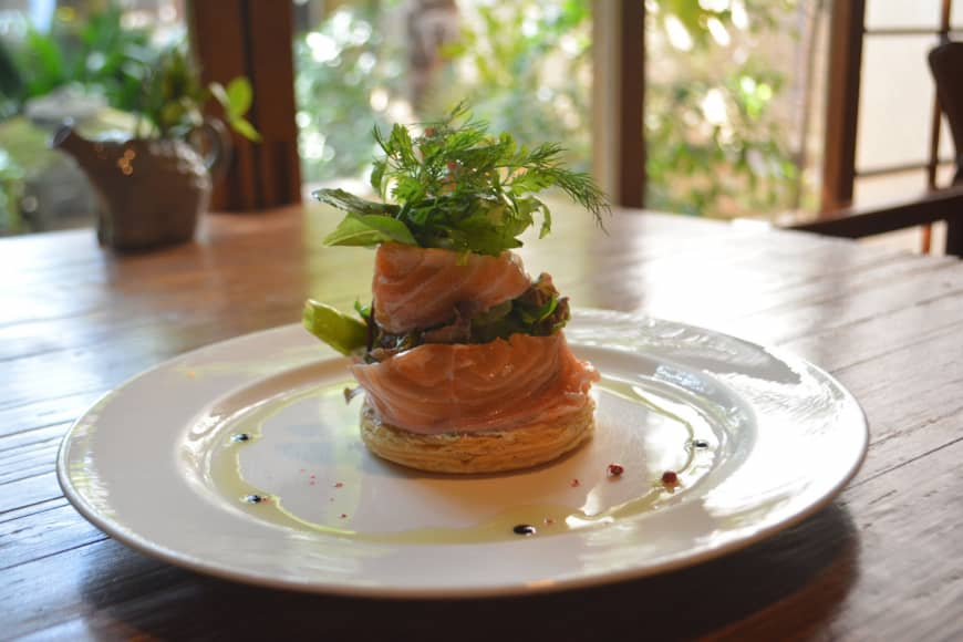 House favorite: Puff pastry wrapped in thin slices of marinated salmon, encasing goat cheese and a salad dressed in dill. | J.J. O'DONOGHUE
