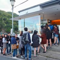 Queue for a brew: Customers wait in line for coffee at % Arabica.   KATHERINE WHATLEY