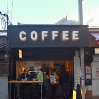 Just drop in: Customers fill-up one of Drip & Drop Coffee Supply's coffee stands.   KATHERINE WHATLEY