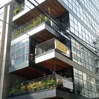 Chic environs: Social Good Roasters is housed in the green Landpool Kanda Terrace building in Tokyo's Kanda district. | CLAIRE WILLIAMSON