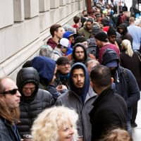Taking the high road: People wait in line for the opening of a Quebec Cannabis Society store in Montreal on Oct. 17, the day Canada legalized recreational marijuana. | REUTERS