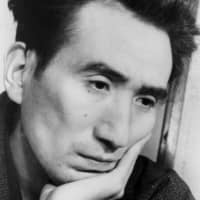 Humanity lost: A photograph of Osamu Dazai, taken in February 1948, the year he published 'Ningen Shikkaku,' and just four months before his death by suicide. | SHIGERU TAMURA