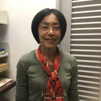 Yumiko Tamura, 57, Secretary (Japanese): I commute for about two hours every day by train. During that time I'll look at my smartphone or I'll read a book.