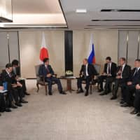 Meeting in Singapore on Nov. 14, Prime Minister Shinzo Abe and Russian President Vladimir Putin agreed to speed up talks on a peace treaty their two countries negotiated after World War II but the Soviet Union refused to sign. | AFP-JIJI