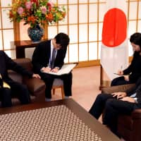Foreign Minister Taro Kono meets with South Korea's ambassador to Japan in Tokyo on Oct. 30 following a South Korean Supreme Court ruling ordering a  Japanese steel maker to pay compensation for wartime 'forced labor.'   REUTERS
