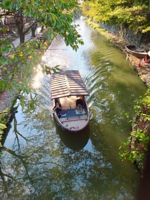 Boating to the biennale: A small boat sits in one of Omihachiman