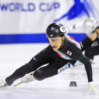Kazuki Yoshinaga finishes first in the men's 1,500-meter final at the short track World Cup in Calgary, Alberta on Saturday. | KYODO