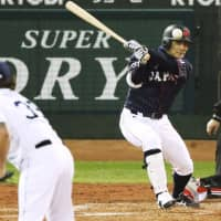 Samurai Japan's Kosuke Tanaka lashes a game-tying single in the ninth inning against the MLB All-Stars in Game 4 of the Japan All-Star Series at Mazda Stadium on Tuesday. Japan rallied for a 5-3 victory. | KYODO