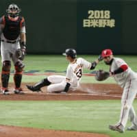 The Giants' Seiya Matsubara slides into home plate in the fourth inning to complete an inside-the-park home run on Thursday.   KYODO