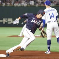 Japan's Shogo Akiyama had three hits, including a third-inning triple, in Game 2 of the Japan All-Star Series. | KYODO