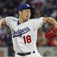 MLB All-Stars starter Kenta Maeda pitches against Samurai Japan on Tuesday night. Maeda tossed two scoreless innings. | KYODO