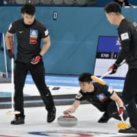 The Japan men's curling team competes against New Zealand at the Pacific-Asia Curling Championships on Friday in Gangneung, South Korea. | KYODO
