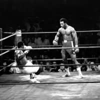 Heavyweight champion Joe Frazier is knocked to the canvas for the third time by George Foreman in the first round of their title fight in Kingston, Jamaica, on Jan. 22, 1973. Foreman won by TKO in the second round. | AP