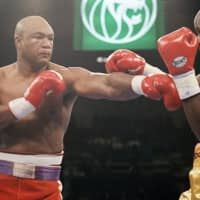 Challenger George Foreman throws a punch at heavyweight champ Michael Moorer during their title fight on Nov. 5, 1994, in Las Vegas. Foreman, then 45, knocked out the 27-year-old Moorer in the 10th round to regain the crown. | AP