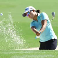Nasa Hataoka plays a shot out of a bunker in the first round of the CME Group Tour Championship in Naples, Florida, on Thursday. Hataoka is one shot off the lead. | KYODO