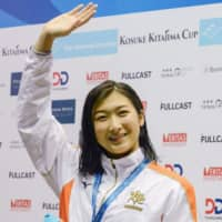 Rikako Ikee waves to fans after setting a new national record in the women's 100-meter freestyle at the Kosuke Kitajima Cup on Sunday.