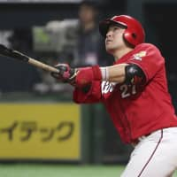 Hiroshima's Tsubasa Aizawa hits a home run in the sixth inning on Thursday. | KYODO