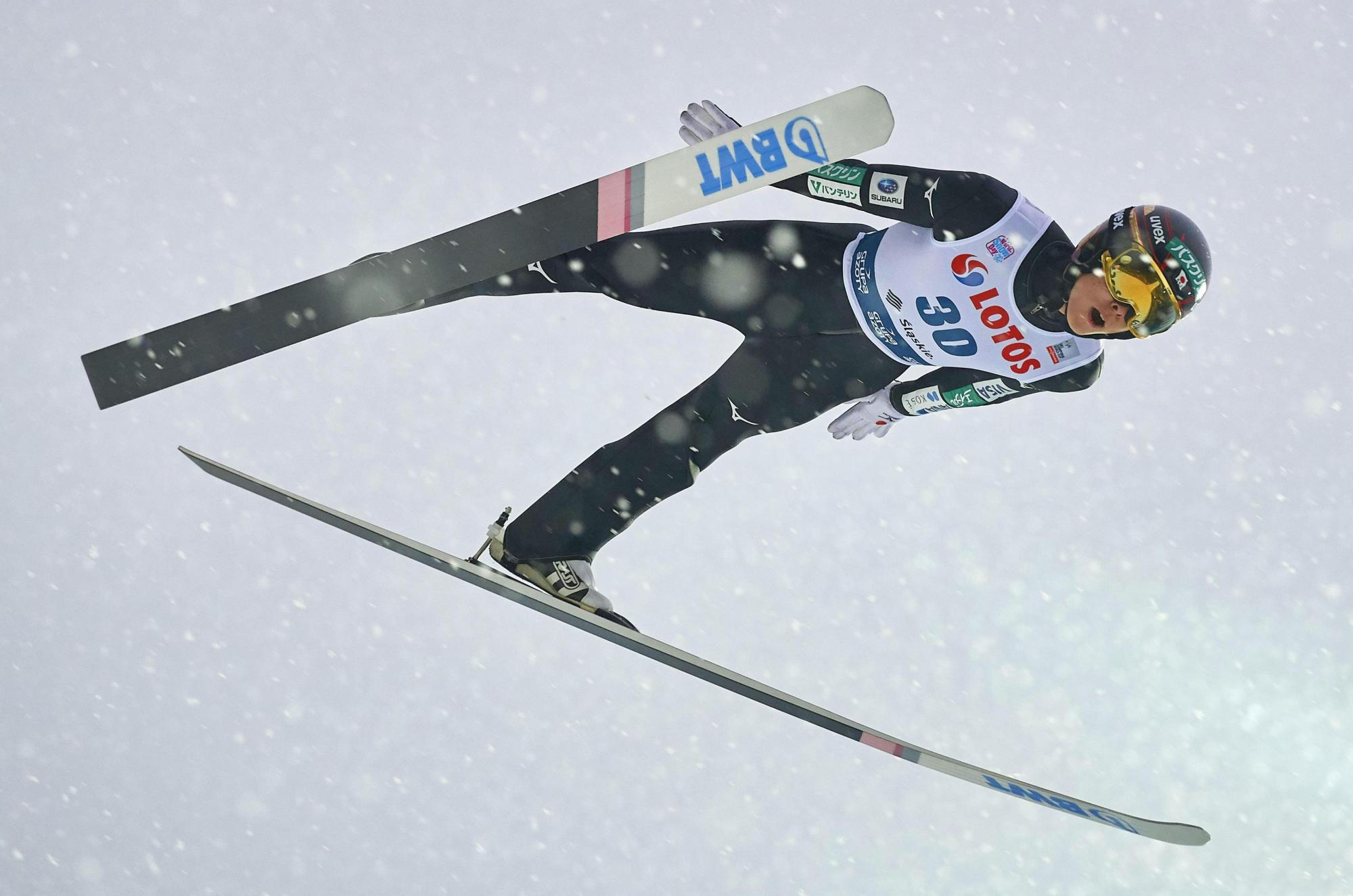 Ryoyu Kobayashi competes during a ski jumping World Cup event on Sunday in Wisla, Poland. Kobayashi placed third to record his first-ever podium finish. | KYODO