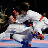 Miho Miyahara (right) fights with Turkey's Serap Ozcelik Arapoglu during the Kumite female 50kg competition at the 24th Karate World Championships in Madrid on Saturday. | AFP-JIJI