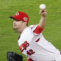 Kris Johnson's Game 2 start for the Carp led the CL representatives to their only win of the series. | KYODO