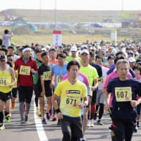 Fukushima marathons drawing runners supporting area's reconstruction
