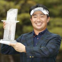 Kodai Ichihara poses with his trophy after carding an 8-under 63 on Sunday to win the Dunlop Phoenix in Miyazaki.