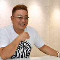 Comedian Mikio Date, one half of popular duo Sandwich Man, speaks during an interview with The Japan Times. | YOSHIAKI MIURA