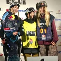 Reira Iwabuchi (center) stands at the podium after winning the women's World Cup big air competition on Saturday in Modena, Italy. Miyabi Onitsuka (left) won silver while Austria's Anna Gasser took bronze.