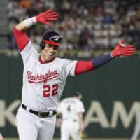 Juan Soto celebrates as he rounds the bases after hitting a two-run home run for the MLB All-Stars in Game 1 of the Japan All-Star Series on Friday at Tokyo Dome. | KYODO