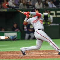 Juan Soto drives in a run for the MLB All-Stars with a double off the ceiling in the team's 9-6 win over Samurai Japan on Saturday. | AFP-JIJI